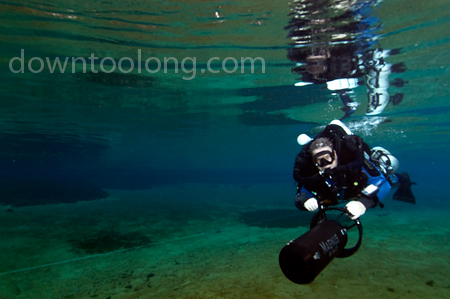 Bill Trent testing a Silent Submersion scooter at Jackson Blue